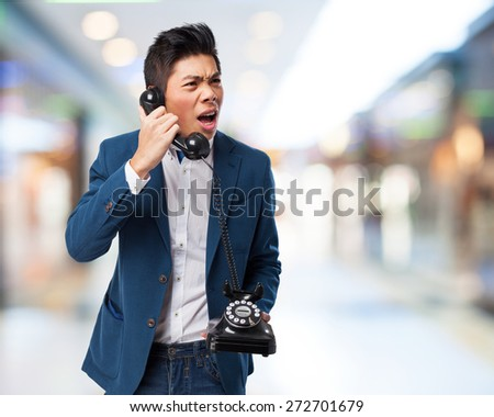 chinese man talking with telephone