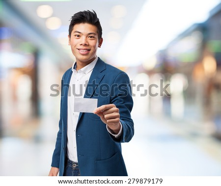 chinese man with visit card - stock photo