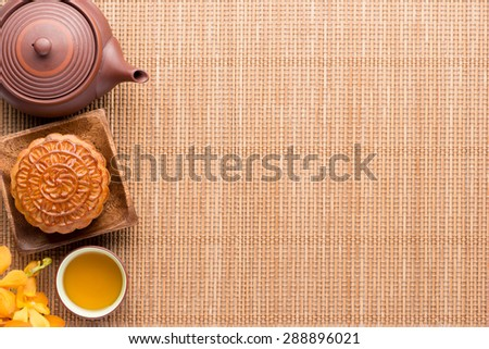 Chinese mid autumn festival foods. Traditional mooncakes on table with copyspace - stock photo