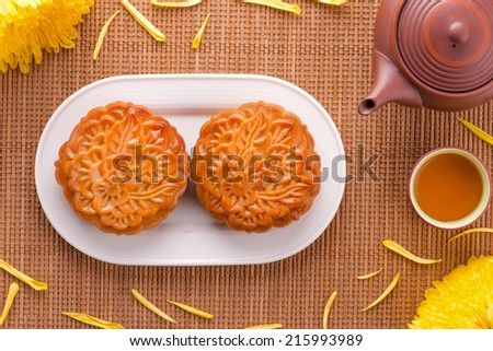 Chinese mid autumn festival foods with blank copy space. Traditional mooncakes on table setting with teacup. Above table view - stock photo