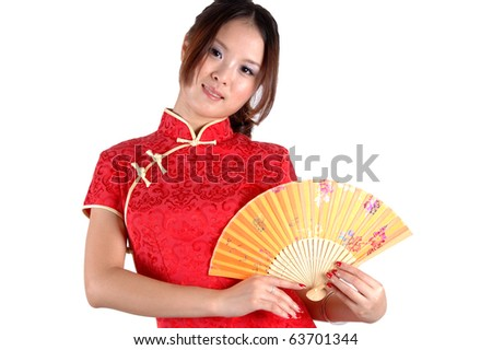 Chinese model in traditional dress called QiPao, holding fan. Asian cute girl, young model with friendly and happy face expression.
