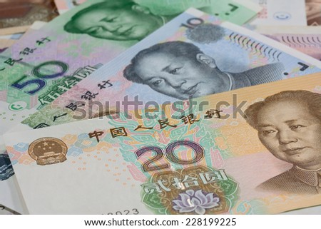 Chinese money (renminbi)  -   Yuan bank notes. Concept photo for money ; selective focus with blur background - stock photo
