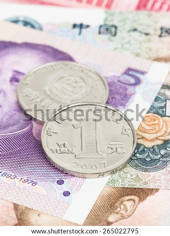 Chinese money yuan banknote and coin close-up - stock photo