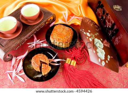 Chinese moon cake and tea-- food for Chinese mid-autumn festival - stock photo