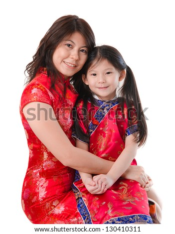 Chinese mother and daughter in traditional china dress isolated on white background - stock photo