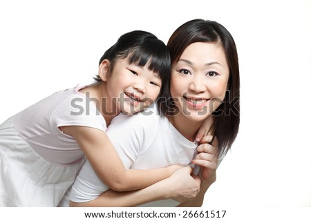 Chinese mother piggyback daughter smiling happily. Isolated in white. - stock photo