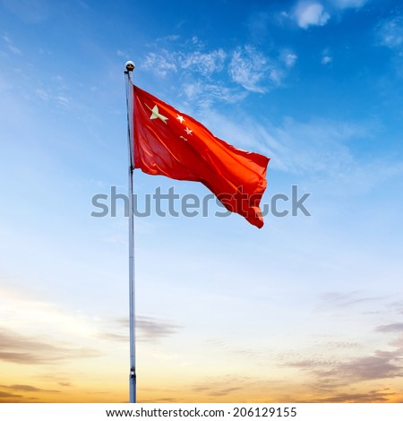 Chinese national flag with blue sky as background - stock photo