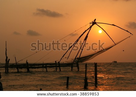 chinese net at sunset in fort cochin, kochi, kerala, india - stock photo