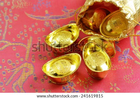 Chinese new year and gold ingots - stock photo