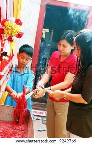 Chinese New Year celebrations in Phuket, Thailand. People light incense at  a temple to pray on the first day of the 3-day vacation.