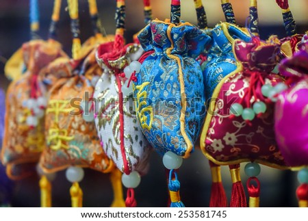 Chinese New Year Decoration bags or  ang pow hanging in a shop window. - stock photo