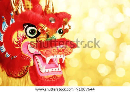 Chinese New Year Decoration--Closeup of Dancing Dragon on festive background. - stock photo