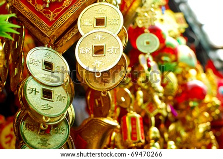 chinese new year decoration items , hanging gold coin with the letter of wealthy - stock photo