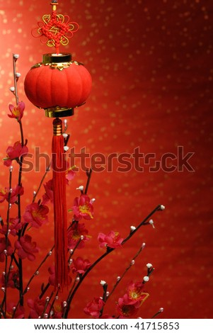 Chinese new year decoration--Red lantern and Siverbud willow on a festive background. - stock photo