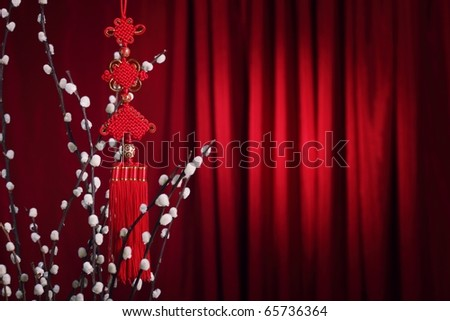 Chinese New Year Decoration--Traditional chinese decorative knot and Silverbud willow on a festive background. - stock photo