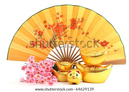 Chinese new year decoration--Traditional fan with Gold Ingot,Piggy Bank and Plum Blossom. - stock photo