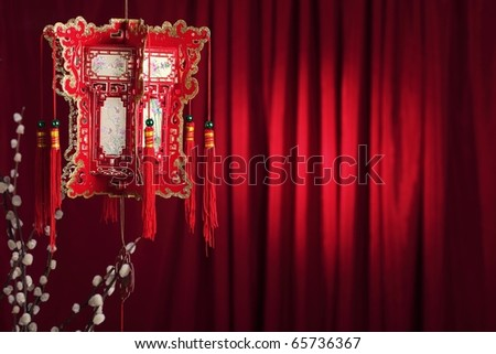 Chinese new year decoration--Traditional paper lantern and Silverbud willow on a festive background. - stock photo