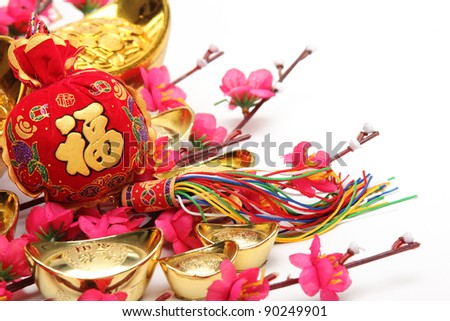 Chinese New Year Decorations,Closeup on money bag   with gold ingots and plum blossom.