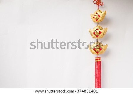 chinese new year decorations.fake gold ingot best for lucrative in the coming new year:words mean good luck and good health for the coming chinese new year - stock photo