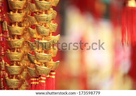 chinese new year decorations.fake gold ingot best wishes for wealthy in the coming new year - stock photo