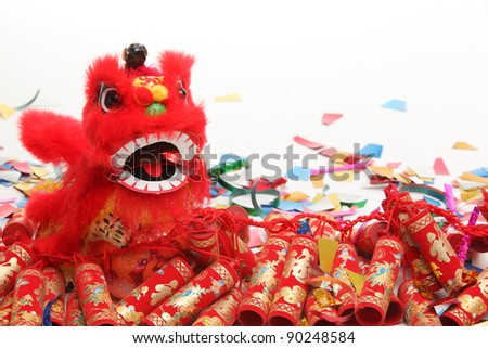 Chinese New Year Decorations--Traditional Dancing Lion,Firecrackers and Confetti. - stock photo