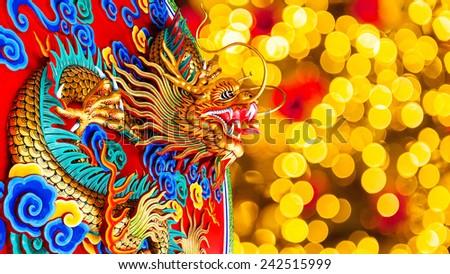 Chinese New Year Dragon Decoration on festive background. - stock photo