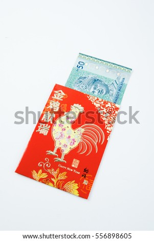Chinese new year festival decorations, red packet or ang pow is given to children and elders during chinese new year for blessing . Envelope with money .