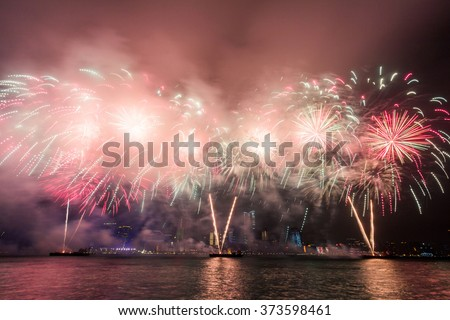 Chinese New Year Fireworks along Victoria Harbor in Hong Kong.  - stock photo