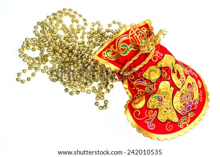 Chinese New Year Gift Bag and Gold ingot Ornament on White Background , Isolated - stock photo