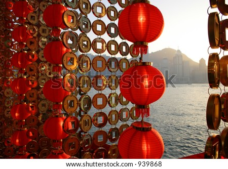 Chinese New Year lantern and gold coin decorations along the Hong Kong harbor. - stock photo