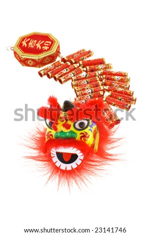 Chinese new year lion head and fire cracker ornaments arranged on white background - stock photo