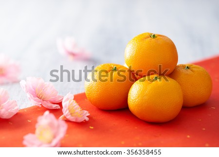 Chinese New Year - Mandarin orange and flowers  - stock photo