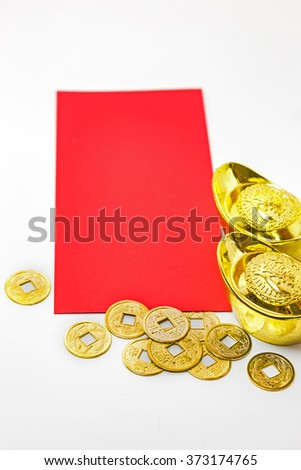 "Chinese new year ornament. Gold ingots , red bag or ang pow and copper coins (Foreign text means ""fortune"" or ""good luck"")"