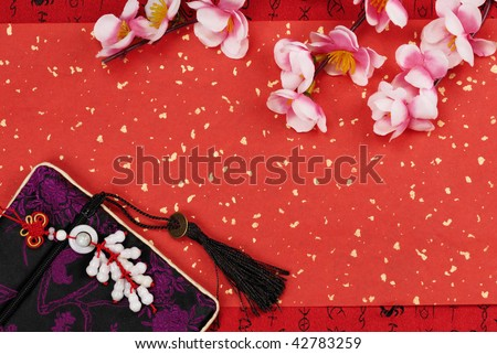 Chinese new year ornament on a festive background. - stock photo