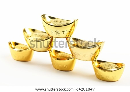 Chinese new year ornament--Stack of gold ingots on white background. - stock photo