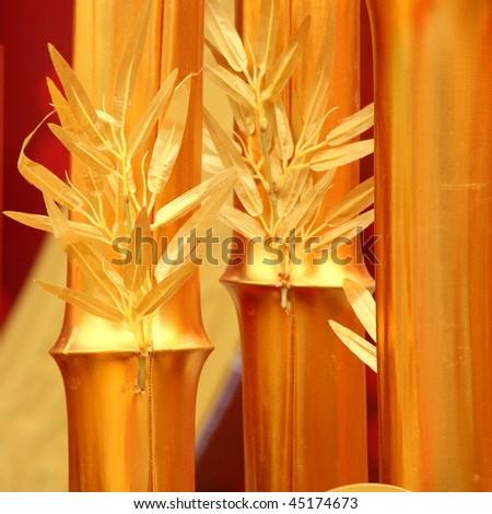 chinese new year scene, man-made golden bamboo - stock photo