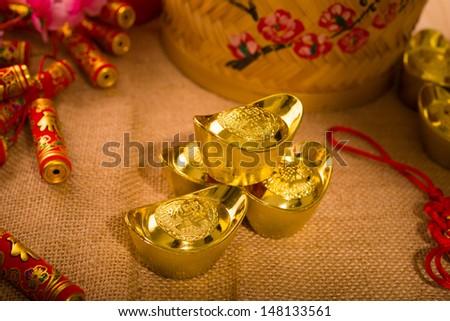 Chinese new year with decoration, large gold ingot and mandarin oranges - stock photo