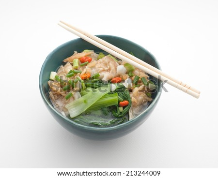 Chinese noodle soup with pork and spinach - stock photo