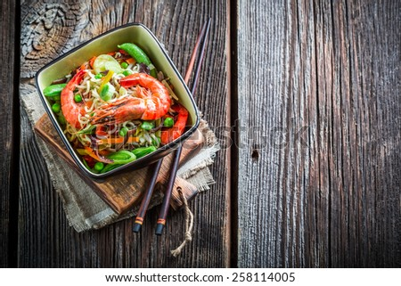 Chinese noodles, vegetables and prawns - stock photo