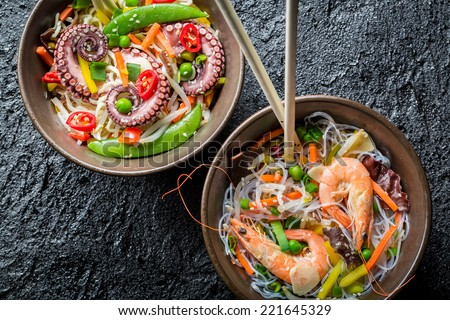 Chinese noodles with vegetables and seafood - stock photo