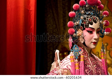 chinese opera dummy and red cloth as text space ,it is a toy,not real man - stock photo