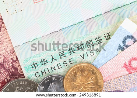 Chinese or Yuan banknotes money and coins from China's currency with visa for travel concept, close up view as background - stock photo