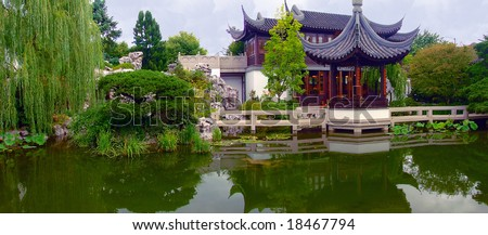 Chinese pagoda with reflection in water in portland OR - stock photo