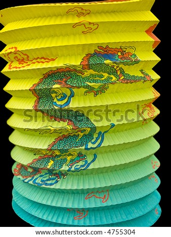 Chinese paper lantern with painted dragon, on  black background with clipping path - stock photo