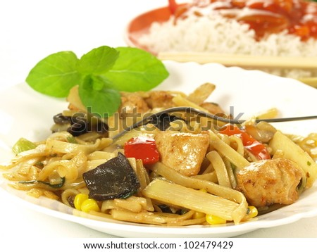 Chinese pasta with chicken, vegetables and mushrooms - stock photo