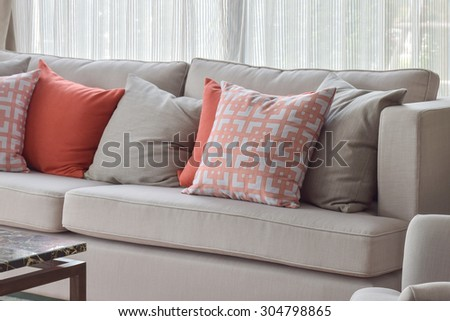 Chinese pattern pillow, red and gray pillows setting on light gray comfy sofa - stock photo