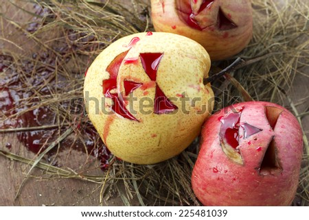 Chinese pear and apple for halloween on hay and blood - stock photo