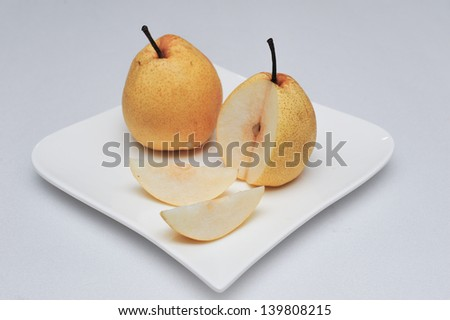 Chinese pear on white dish - stock photo