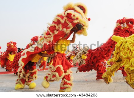 Chinese people playing lion dance celebrating the coming new year. - stock photo