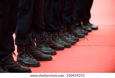 Chinese policemen in a line. - stock photo